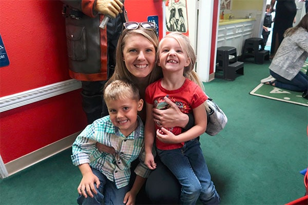 Happy mom with two little kiddos at a Preschool & Daycare Serving Hesperia, CA
