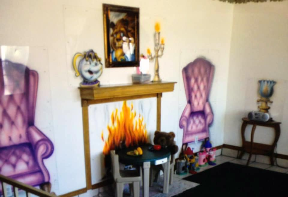 Painting on the wall of a fireplace and an elegant sofa , artistic design at a Preschool & Daycare Serving Hesperia, CA