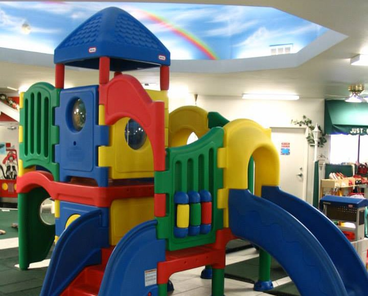 Colorful plastic indoor playhouse with slide at a Preschool & Daycare Serving Hesperia, CA