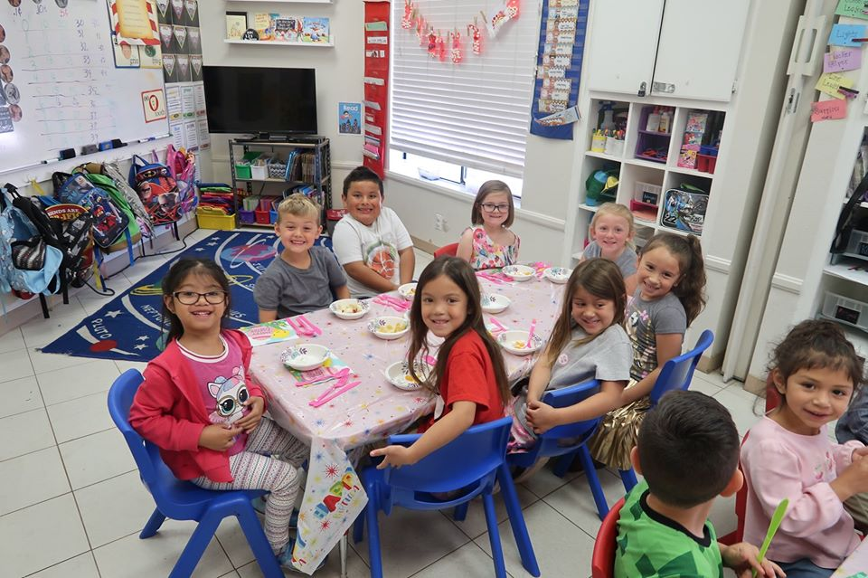 Excited group of preschool kids waiting for meal at a Preschool & Daycare Serving Hesperia, CA