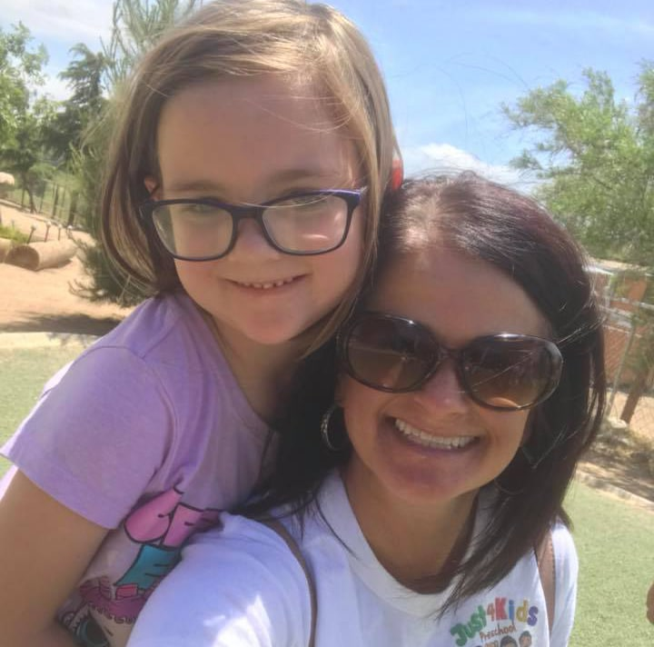 Happy mom and daughter both wearing glasses at the school yard at a Preschool & Daycare Serving Hesperia, CA