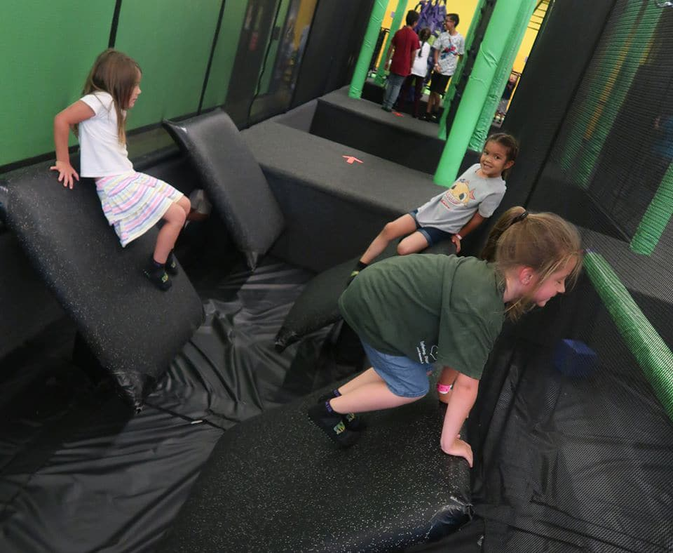 Group of little girls playing in an indoor playground t a Preschool & Daycare Serving Hesperia, CA