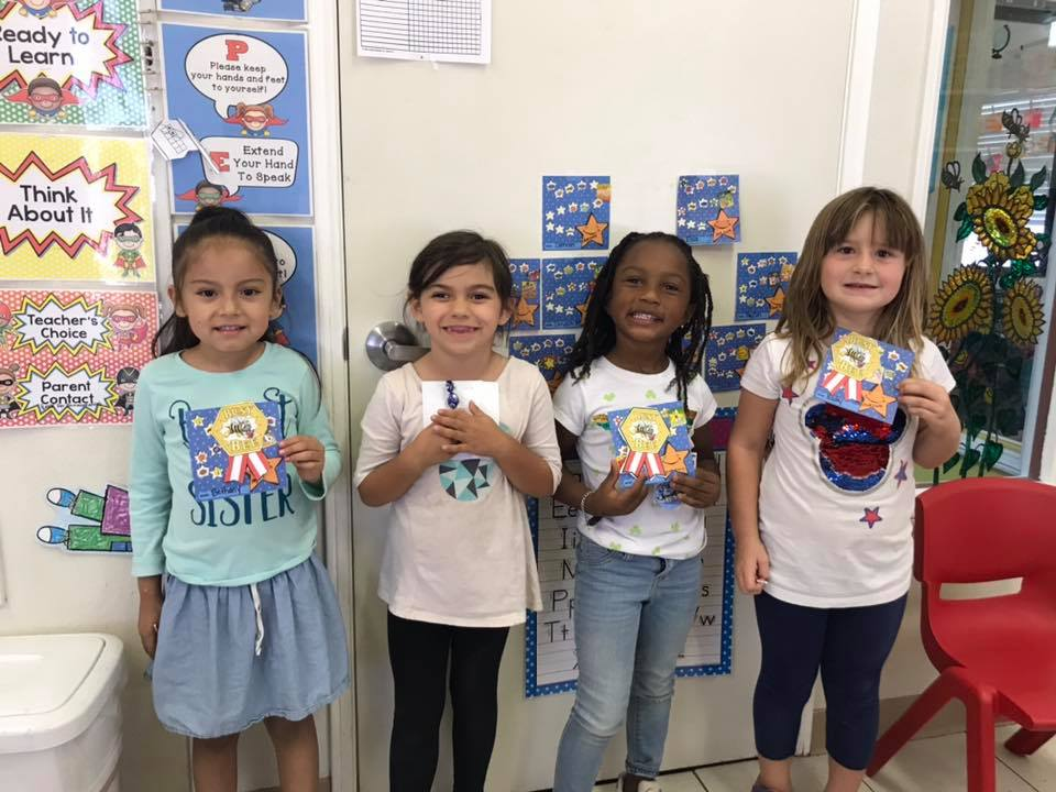 Diverse young little preschool girls holding an award at a Preschool & Daycare Serving Hesperia, CA