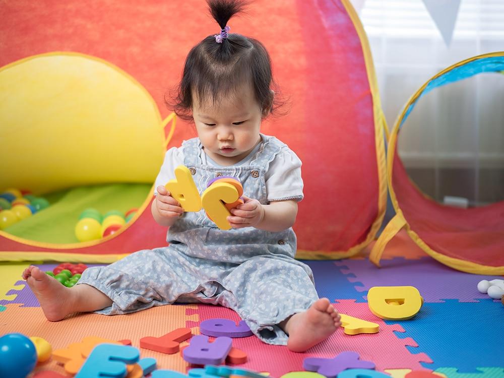 baby girl learning alphabet blocks at a Preschool & Daycare Serving Hesperia, CA